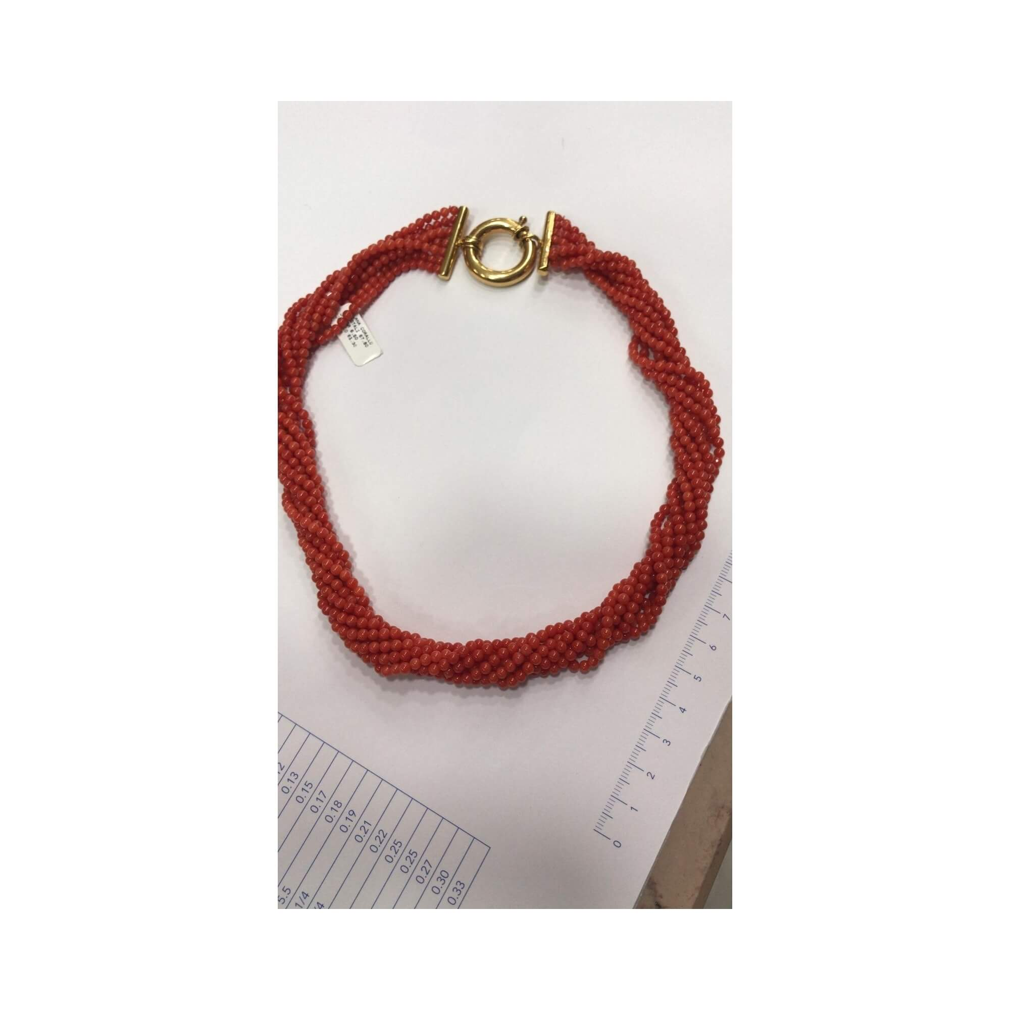Neckalces made with coral beads and gold clasp