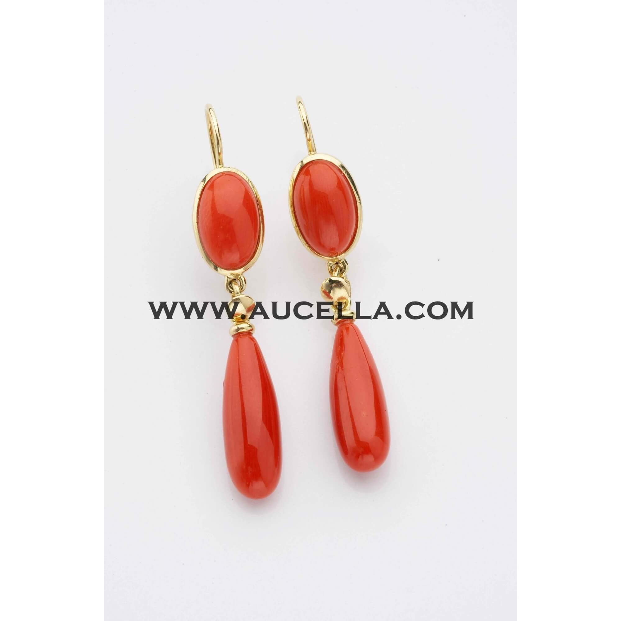 Classic style earrings set in gold with coral drops