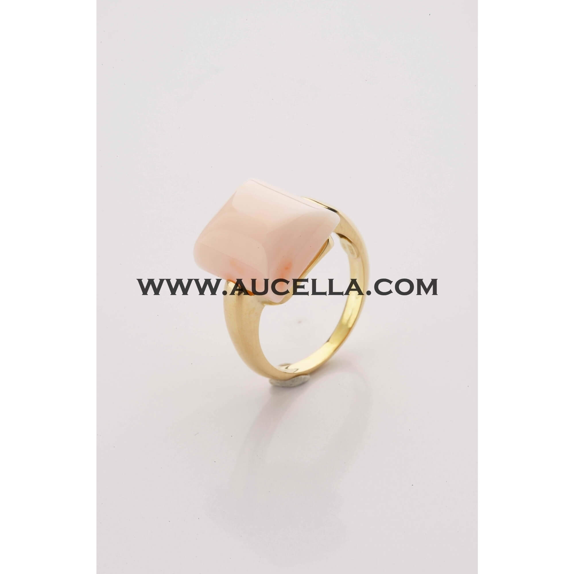 Ring set in gold with natural coral square cabochon