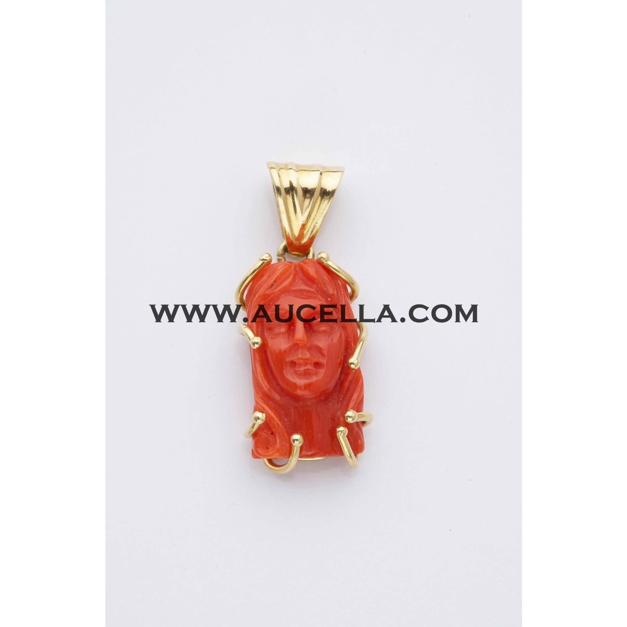 Pendant set in gold with Jesus face carving